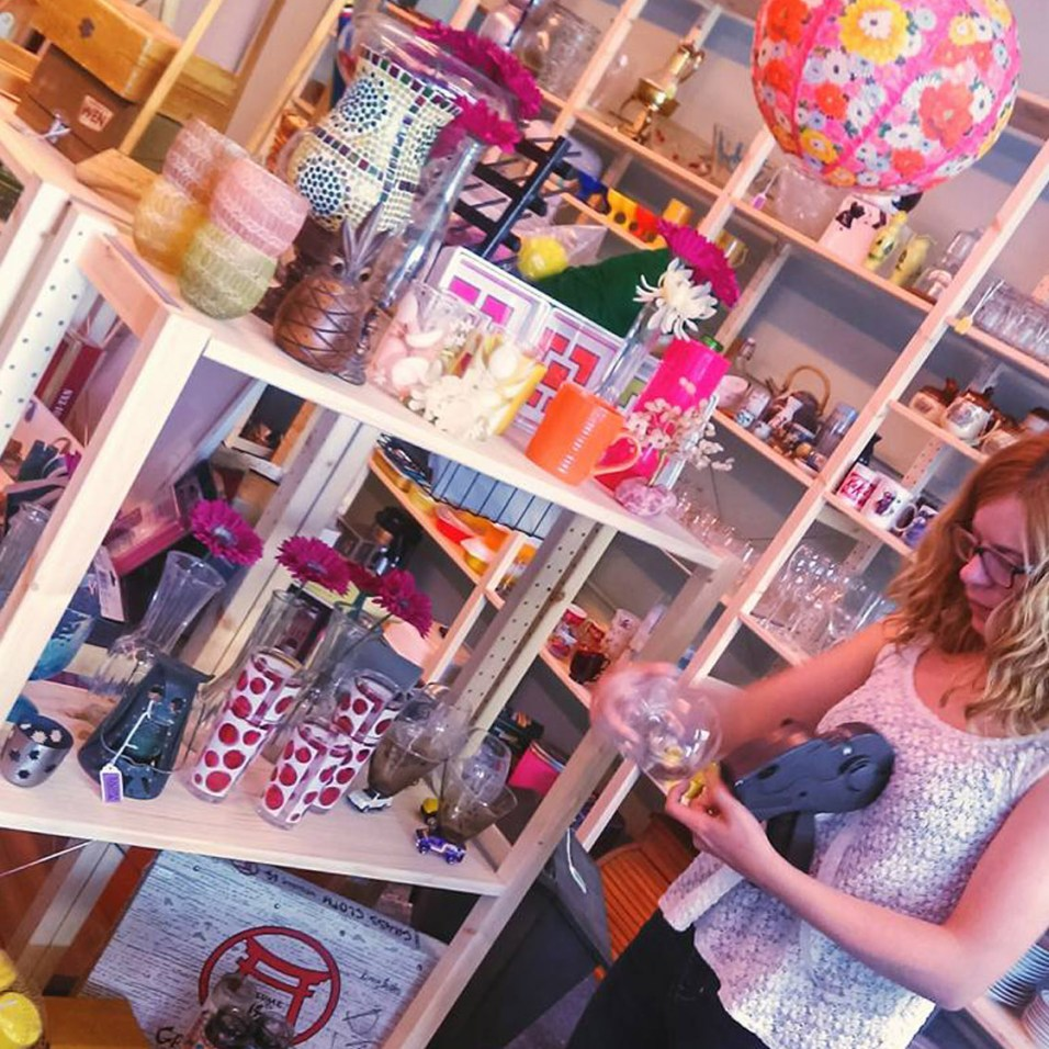 Jessica Prindel places final price tags on merchandise before the Grand Opening of Tacoma Thrift & Consignment. The entrepreneur received training through Spaceworks' 'Creative Enterprise Tier I' class of spring 2016. Photo courtesy of Spaceworks.