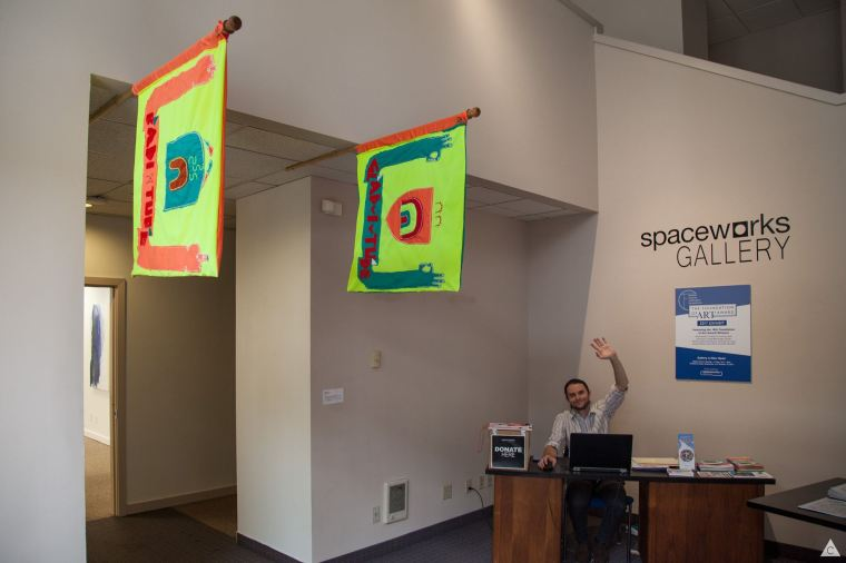 Gabriel Brown greets visitors at the Spaceworks Gallery. Photo by Kris Crews.
