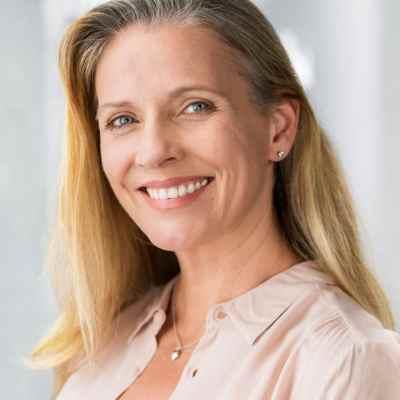 smiling older woman with veneers improve my teeth