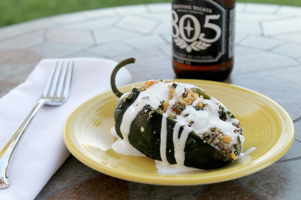 Roasted poblano pepper stuffed with mushrooms, breadcrumbs and cheese, topped with a drizzle of crema fresca.