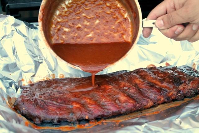 Homemade barbecue sauce on smoked ribs 10