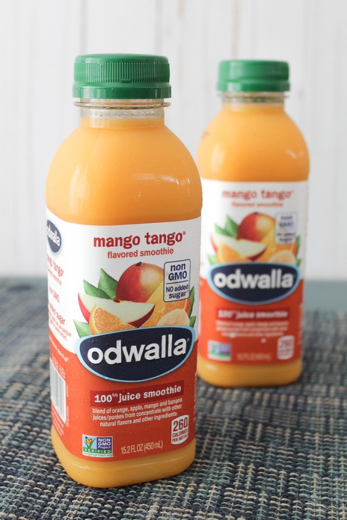 Close-up of two Odwalla® Mango Tango® bottles on a table.