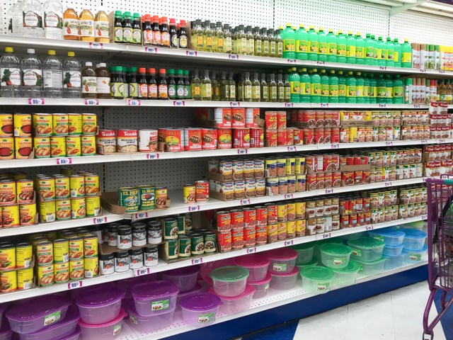 Grocery store shelves with condiments.