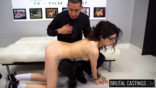 Pornstar Ava Taylor gets a nude spanking with her wrists tied together in this rough sex scene