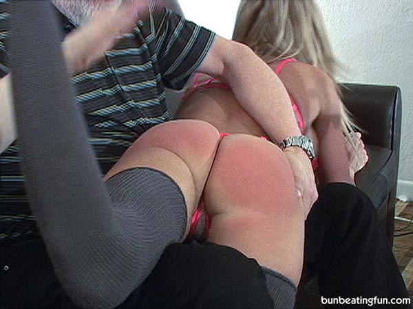 Mya's big bottom gets quite red from the hard spanking