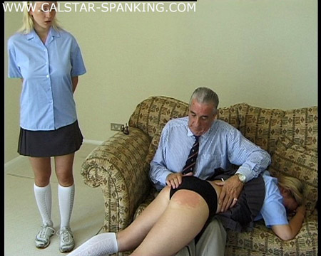 Two schoolgirls get spanked OTK
