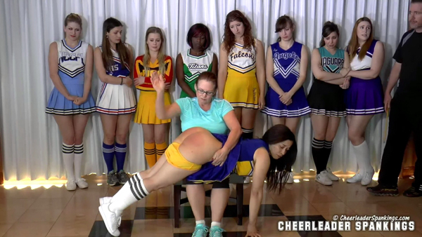 Miss Elizabeth spanks Mackenzie Reed OTK in front of the other cheerleaders