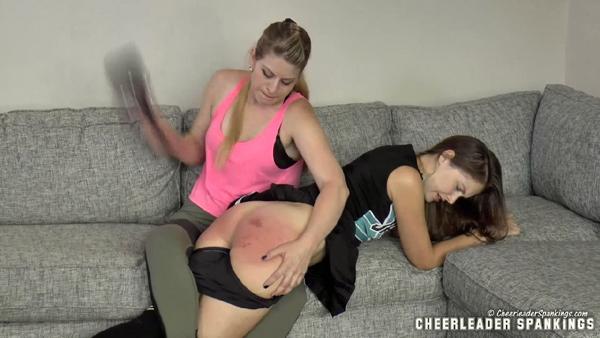 Petite brunette cheerleader Rachel Adams gets a nice hard OTK paddling