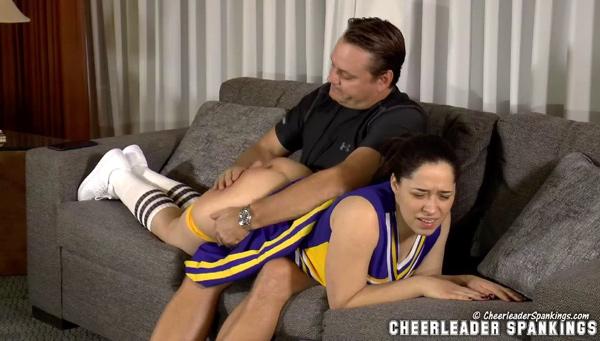 Cheerleader Mackenzie Reed gets an OTK hand spanking on the bare bottom by coach, Johnny Lake