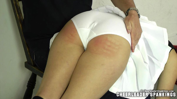 Rosie Ann's Cheerleader Initiation includes an OTK spanking and a bare bottom strapping