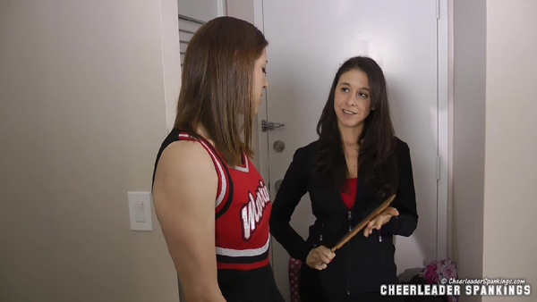 Coach Sarah Gregory finds cheerleader Zooey Zara hiding in the closet