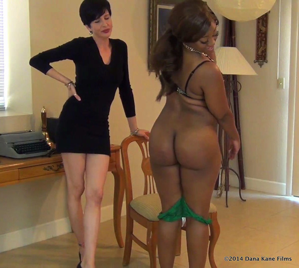 Erica inpects her spanked and caned bottom