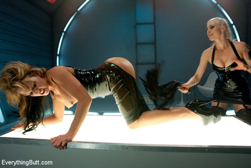 Nikki Sexx is on all fours in a bottom-less latex dress getting her ass whipped