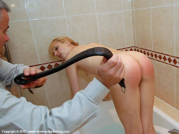 Amelia Jane Rutherford bends over for the strap naked in bathtub