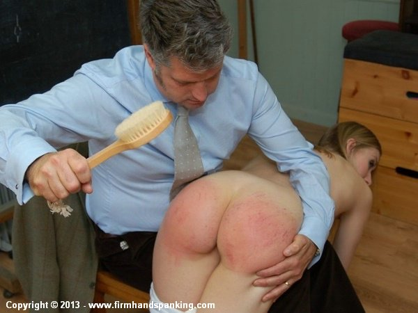 After a strip search naughty Belinda Lawson is paddled in the nude by her teacher
