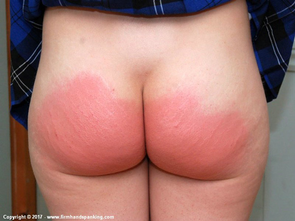 At the end of the punishment Belinda's big bottom is a deep red color