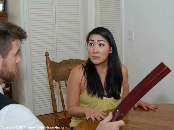 Yumi Bennett is confronted with the leather tawse