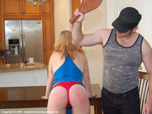 New spanking model Lyra Bryant gets spanked with a leather paddle