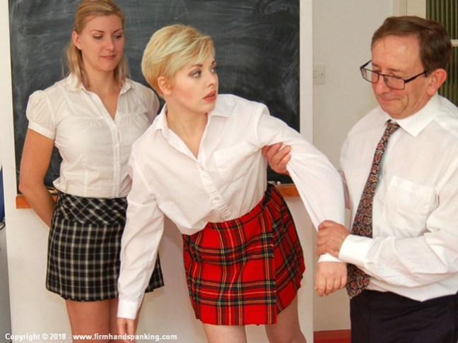 Helen Stephens and Belinda Lawson are in trouble in their school uniforms