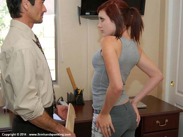 Stacy Stockton gets paddled over her tight jeans by the principal