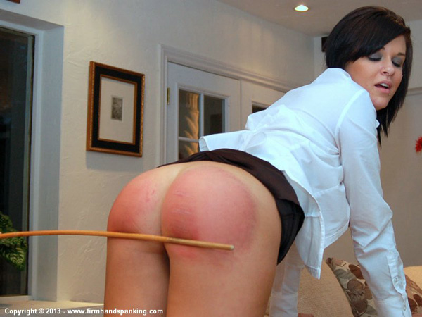 Valerie Bryant counts each stroke as she gets 18 from the cane on her bare bottom
