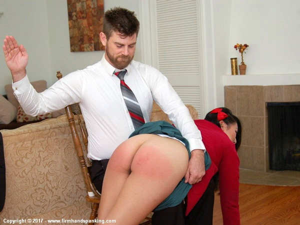 New model Asian Yumi Bennett gets spanked OTK on her bare bottom