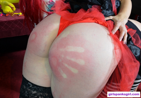 Clown Nova gets a handprint on her red bottom OTK