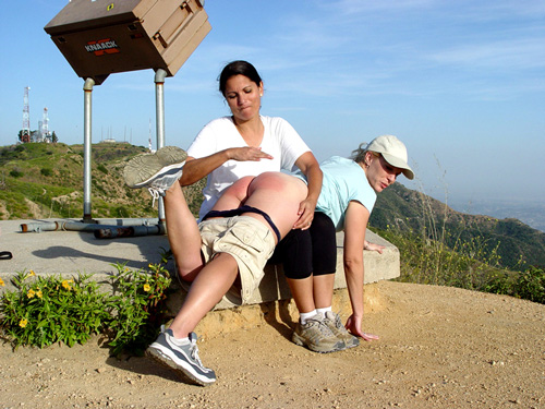 Chelsea Pfeiffer spanks Pixie's bare bottom outdoors in the Californian hills