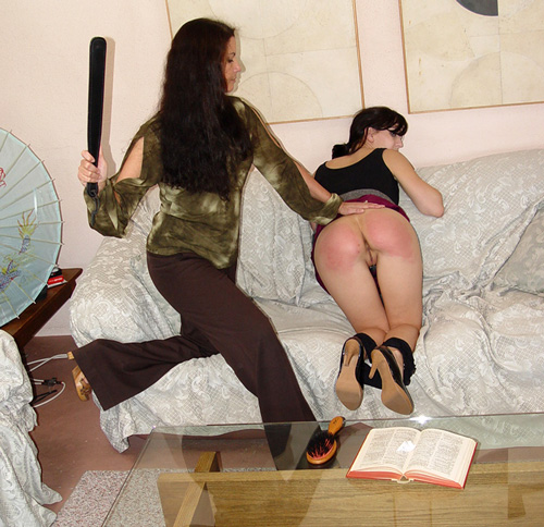 Elise Graves gets the paddle on her bare bottom