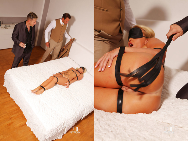 Submissive Kathia Nobili gets whipped and fucked by two cocks