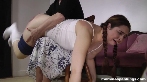 The 1950s spanking scene ends with a well-spanked Adriana Evans having learned her lesson