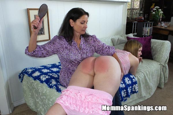 Chelsea spanks Alex Reynolds on her bare bottom with a wooden hairbrush