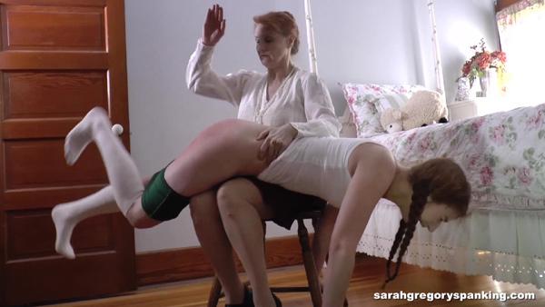 Tasha Lee gives Bianca Rose a hard OTK hand spanking