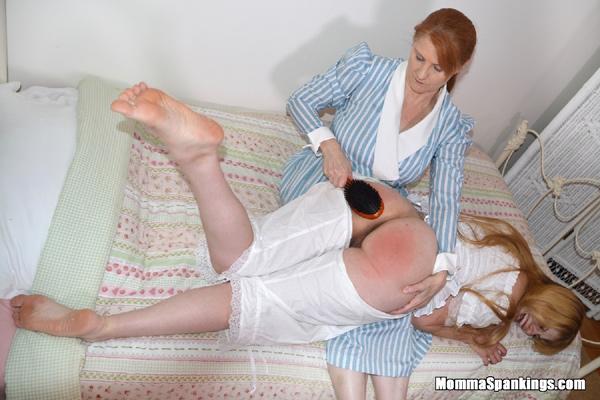 Harley Havik's Big Round Bottom gets spanked with the hairbrush