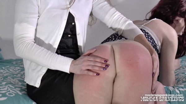Violet's bare bottom gets spanked by Bianca Rose until it is very red at Momma Spankings