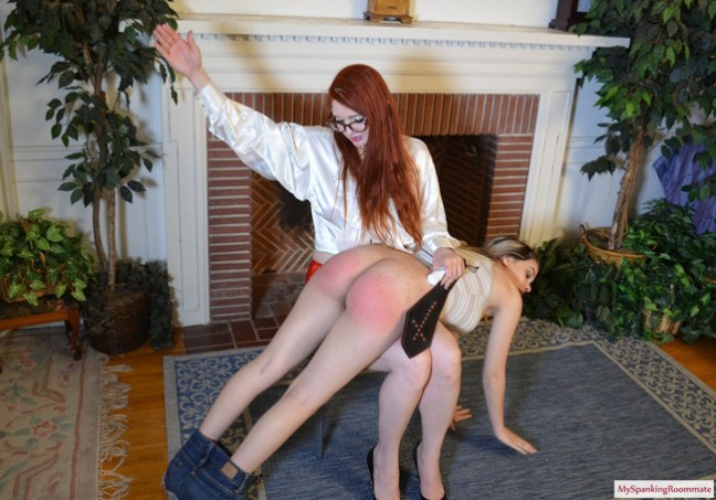 Latina Cora Ora gets a hand spanking and paddling on her bare bottom