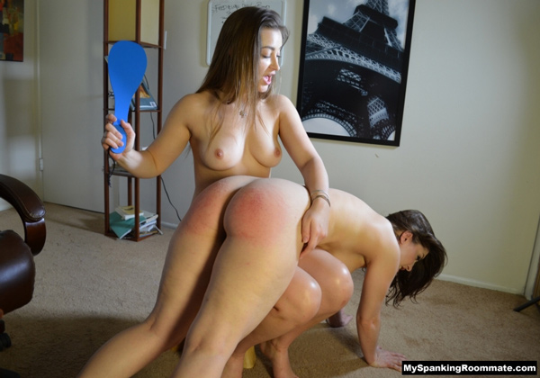 Dani Daniels paddles Kay over the knee with both ladies completely nude