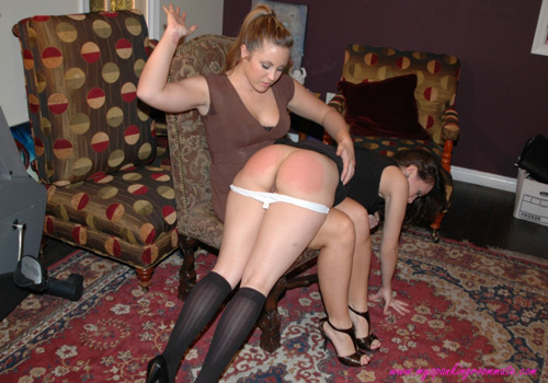 Madison gives Sinn a firm hand spanking on her bare bottom over her knee