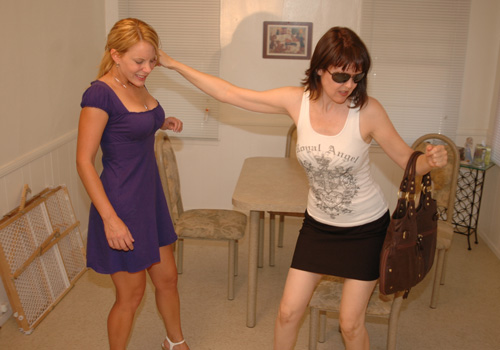 Clare catches Amber Pixie Wells tagging so pulls her over her knee for a spanking