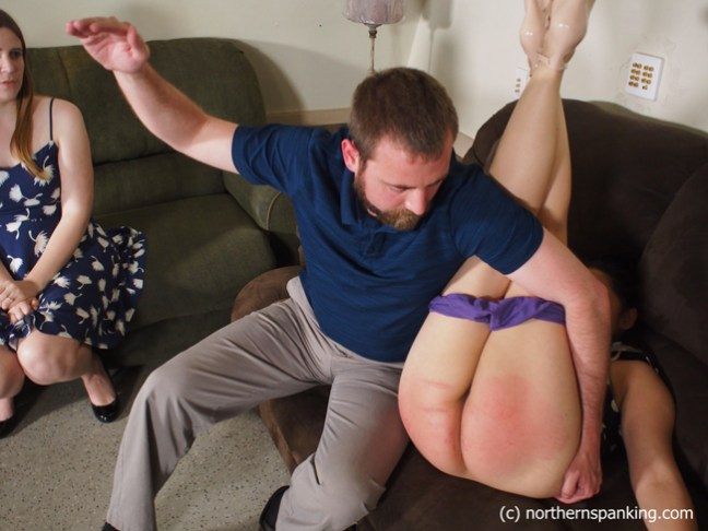 James humiliates Koko Kitten further by spanking her in the diaper position