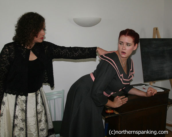 School Governor bends young teacher over a desk to show her how to discipline
