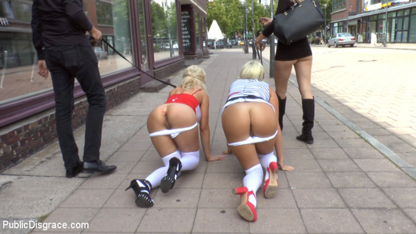 Busty bombshells, Laela Pryce and Manu Magnum, led through the streets like dogs at Public Disgrace