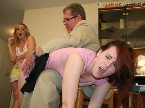 Bronte gets hand spanked by David Pierson OTK as Lily Anna watches and laughs