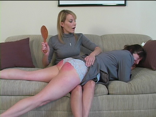 Ms Wells spanks the naughty nanny hard and long with the leather paddle