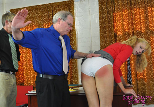 Amelia Jane Rutherford's bottom gets very red while she is spanked in her white panties