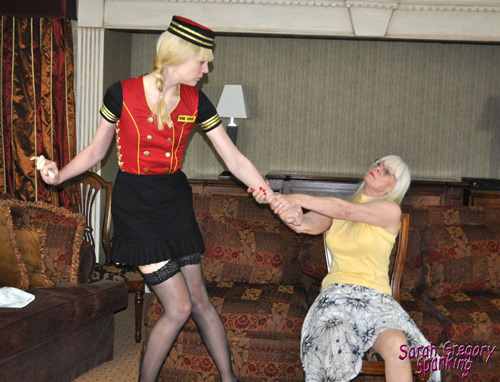 Lazy hotel employee Amelia Jane Rutherford is pulled across Dana's lap