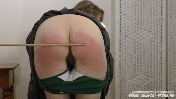 Apricot Pitts bends over for 12 strokes of he cane on her sore, bare bottom