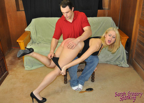 Sarah tries to resist as he pulls down her panties for a bare bottom spanking