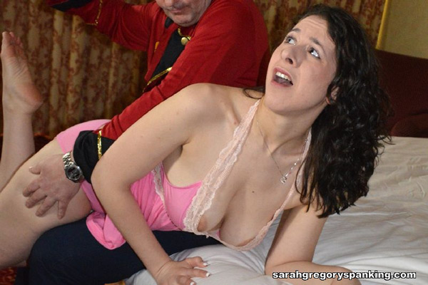 Sarah Gregory's big breasts fall out of her nightie when she gets spanked by the bellhop