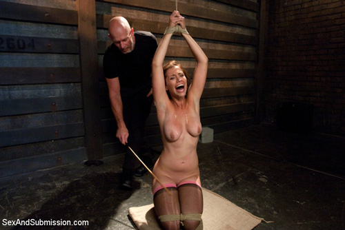Audrey Rose gets tied up in bondage and her boobs and thighs are caned